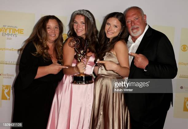 """Chiara D'Ambrosio poses with the award for Outstanding Younger Performer in a Daytime Fiction Program for """"The Bay"""" with Lisa D'Ambrosio, Bianca..."""