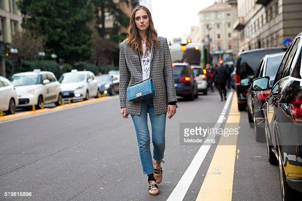 Chiara Ferragani of The Blonde Salad wears a side braid nose ring a Fendi monogramed blazer a L'Oreal slogan tshirt a blue Chanel purse jeans and Miu...