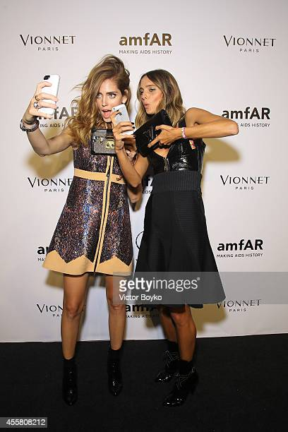 Chiara Ferragni and Candela Novembre attend the amfAR Milano 2014 Gala as part of Milan Fashion Week Womenswear Spring/Summer 2015 on September 20...