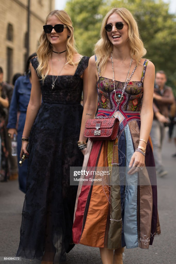Chiara Ferragni and Valentina Ferragni are seen attending Christian Dior during Paris Fashion Week wearing Dior on September 26, 2017 in Paris, France.