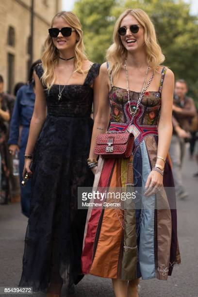 Chiara Ferragni and Valentina Ferragni are seen attending Christian Dior during Paris Fashion Week wearing Dior on September 26 2017 in Paris France