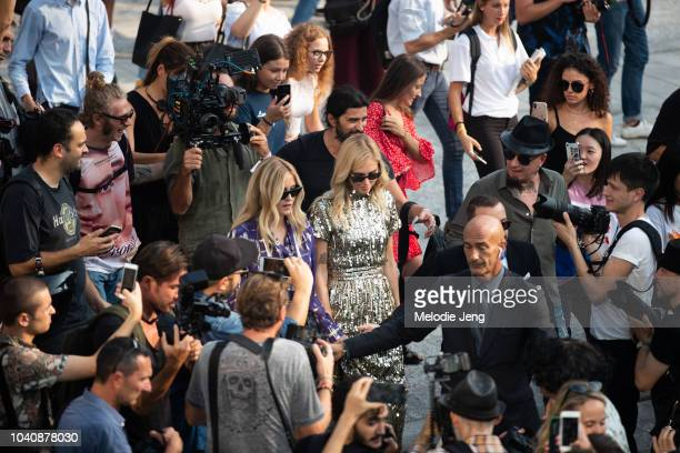 Chiara Ferragni and Valentina Ferragni enter the Alberta Ferretti show surrounded by photographers and fans during Milan Fashion Week Spring/Summer...