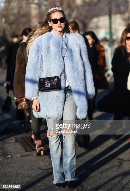 Chiara Ferragni is seen wearing a baby blue fur coat Louis Vuitton purse with a tiara outside the Coach show during New York Fashion Week Women's...