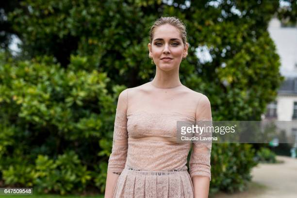 Chiara Ferragni is seen wearing a dress from Dior in the streets of Paris after the Christian Dior show during Paris Fashion Week Womenswear...