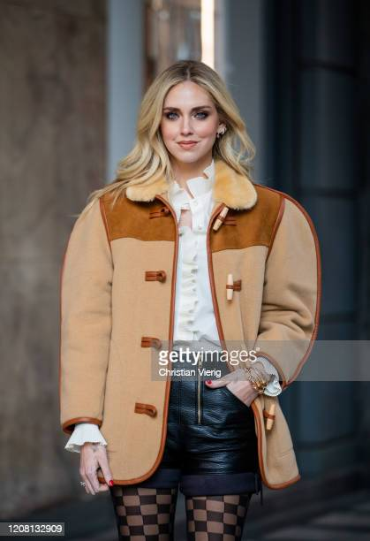 Chiara Ferragni is seen wearing brown oversized jacket and checkered tights Calzedonia, blouse, black shorts during Milan Fashion Week Fall/Winter...