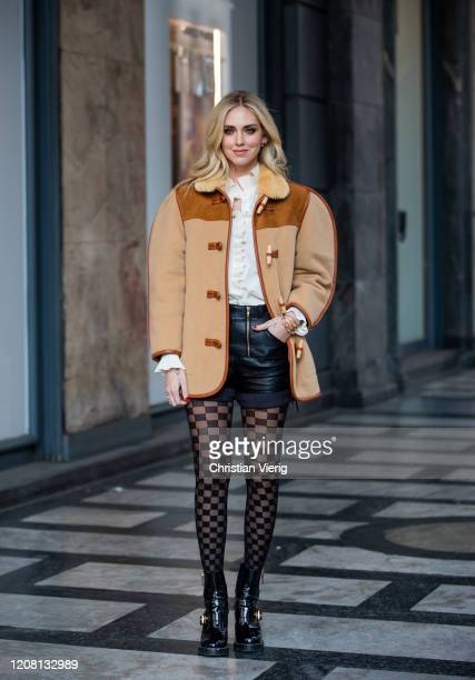 Chiara Ferragni is seen wearing brown oversized jacket and checkered tights Calzedonia blouse black shorts during Milan Fashion Week Fall/Winter...