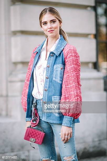 Chiara Ferragni is wearing blue denim jeans, a pink and blue denim jacket, and a pink Chanel bag, outside the Chanel show, during Paris Fashion Week...