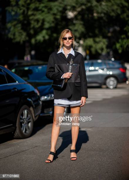 Chiara Ferragni is wearing Prada jacket and Prada bag seen outside Prada during Milan Men's Fashion Week Spring/Summer 2019 on June 17 2018 in Milan...