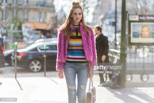 Chiara Ferragni is wearing The Blonde Salad for Levi's ripped jeans Gucci sweater and bag pink Philosophy fur coat vintage sunglasses outside Hermes...