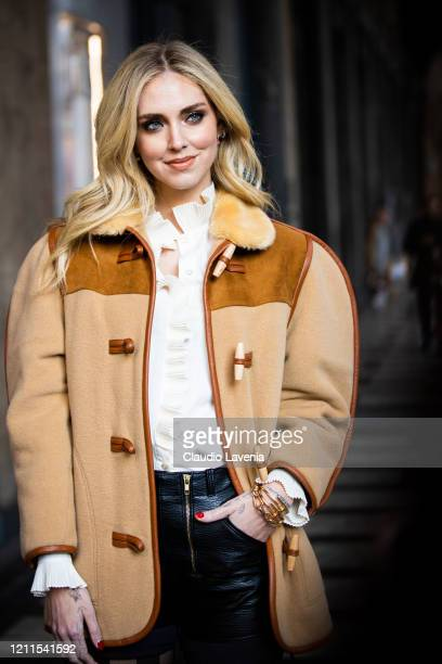 Chiara Ferragni, wearing a beige jacket with fur collar, white shirt, black leather shorts and checked tights, is seen outside Philosophy di Lorenzo...