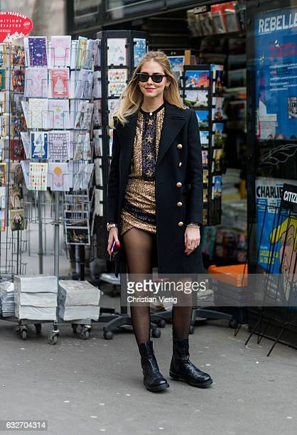 Chiara Ferragni wearing a black coat golden dress tights ankle boots outside Elie Saab on January 25 2017 in Paris Canada
