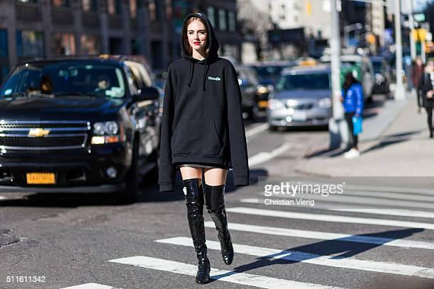 Chiara Ferragni wearing a black Vetements hoody and black Chiara Ferragni collection boots seen outside Calvin Klein during New York Fashion Week...