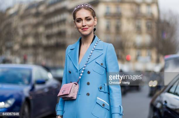 Chiara Ferragni wearing a blue coat platform shoes Chanel mini bag outside Miu Miu on March 7 2017 in Paris France