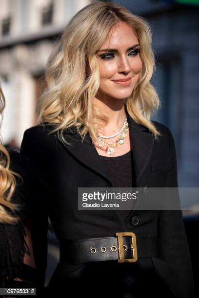 Chiara Ferragni wearing a long black coat with gold belt and black heels is seen outside Christian Dior during Paris Fashion Week Haute Couture...