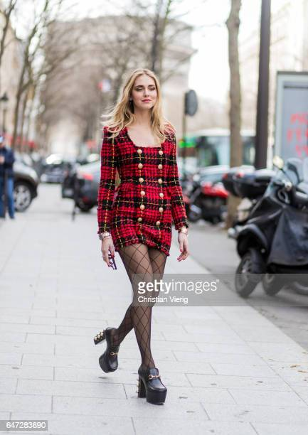 Chiara Ferragni wearing a red checked dress fishnet tights outside Balmain on March 2 2017 in Paris France