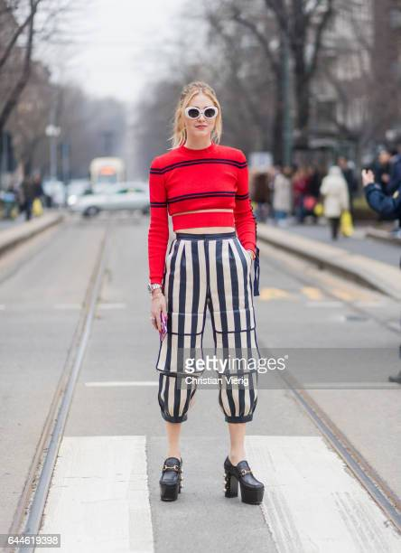 Chiara Ferragni wearing a red knit, striped pants from Fendi outside Fendi during Milan Fashion Week Fall/Winter 2017/18 on February 23, 2017 in...