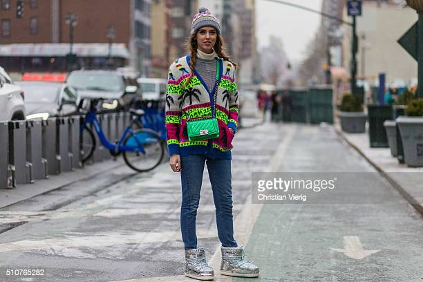 Chiara Ferragni wearing a Saint Laurent sweater green Chanel bag new Chiara Ferragni Collection glitter snow boots seen outside Jeremy Scott during...