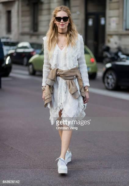 Chiara Ferragni wearing a white dress outside Alberta Ferretti on February 22 2017 in Milan Italy