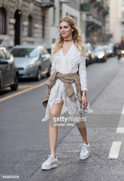 Chiara Ferragni wearing a white dress outside Alberta Ferretti on February 22 2017 in Milan Italy