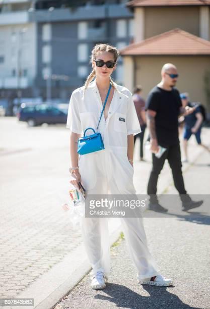 Chiara Ferragni wearing a white jumpsuit is seen outside GCDS during Milan Men's Fashion Week Spring/Summer 2018 on June 19 2017 in Milan Italy