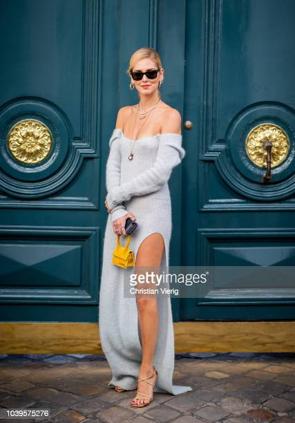 Chiara Ferragni wearing blue off shoulder dress with slit yellow bag is seen outside Jacquemus during Paris Fashion Week Womenswear Spring/Summer...