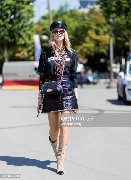 Chiara Ferragni wearing Chanel bag skirt boots flat cap long shirt outside Chanel during Paris Fashion Week Haute Couture Fall/Winter 20172018 Day...