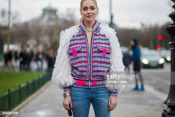 Chiara Ferragni wearing Chanel jacket denim jeans outside Chanel on March 7 2017 in Paris France
