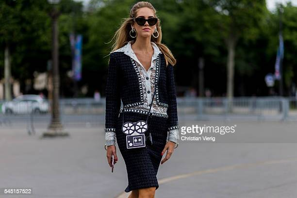 Chiara Ferragni wearing Dior jacket skirt blouse bag and shoes outside Chanel during Paris Fashion Week Haute Couture F/W 2016/2017 on July 5 2016 in...