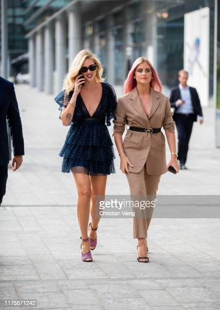 Chiara Ferragni wearing navy sheer dress and Valentina Ferragni wearing beige striped suit seen outside the Alberta Ferretti show during Milan...
