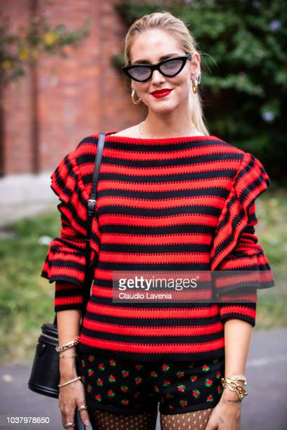 Chiara Ferragni wearing Philosophy black and red sweater and black pants whit roses is seen after the Philosophy by Lorenzo Serafini show during...