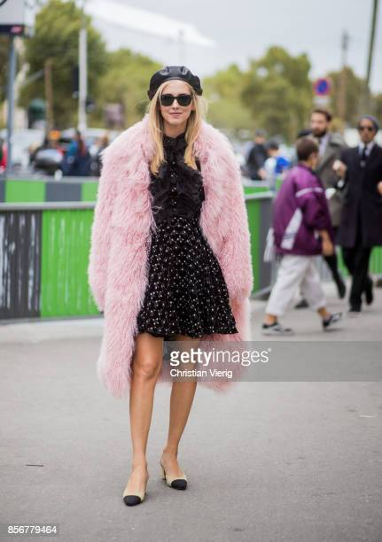 Chiara Ferragni wearing pink fake fur coat beret Chanel shoes seen outside Giambattista Valli during Paris Fashion Week Spring/Summer 2018 on October...