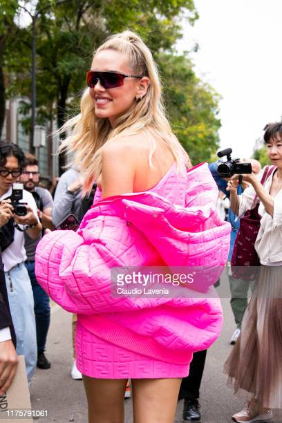 Chiara Ferragni wearing pink oversize jacket and Oakley sunglass poses outside the Fendi show during Milan Fashion Week Spring/Summer 2020 on...