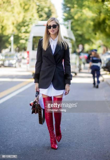 Chiara Ferragni wearing white button dress blazer red overknees Fendi bag is seen outside Fendi during Milan Fashion Week Spring/Summer 2018 on...