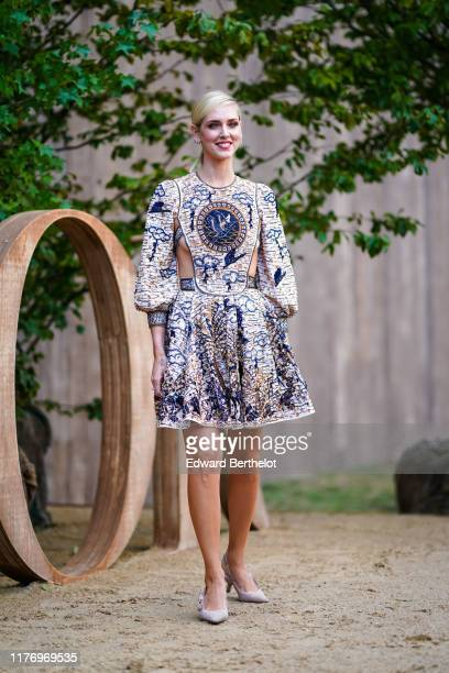 Chiara Ferragni wears a pleated dress with puff sleeves and printed features pointy shoes outside Dior during Paris Fashion Week Womenswear Spring...