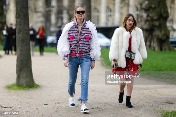 Chiara Ferragni wears a striped tweed colored jacket with white sleeves sunglasses blue denim jeans and black and white sneakers outside the Chanel...