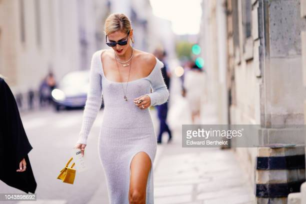 Chiara Ferragni wears a white dress and a yellow bag outside Jacquemus during Paris Fashion Week Womenswear Spring/Summer 2019 on September 24 2018...