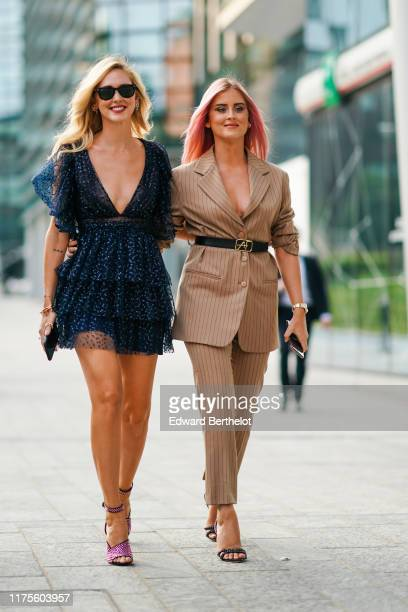 Chiara Ferragni wears sunglasses a blue lace mesh pleated and ruffled low neck dress Valentina Ferragni wears a brown striped blazer jacket a black...
