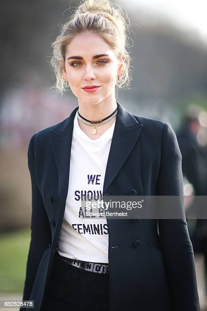 Chiara Ferragni wears sunglasses a white tshirt with the inscriptions ' We should all be Feminists' a black meshed dress black heels and attends the...