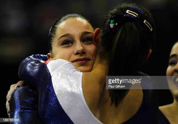 Chiara Gandolfi of Italy celebrates with Erika Fansa after the uneven bars during the Women's Artistic Gymnastics Olympic Qualification round at...
