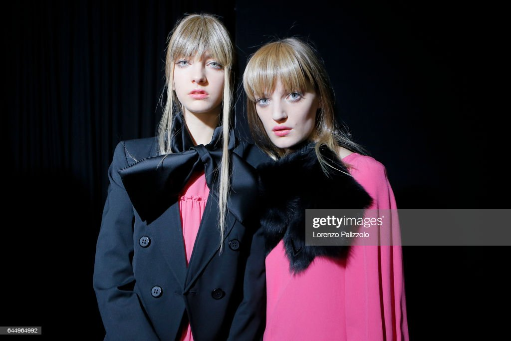 Chiara Leone and model are seen backstage ahead of the Emporio Armani show during Milan Fashion Week Fall/Winter 2017/18 on February 24, 2017 in Milan, Italy.