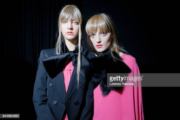 Chiara Leone and model are seen backstage ahead of the Emporio Armani show during Milan Fashion Week Fall/Winter 2017/18 on February 24, 2017 in...