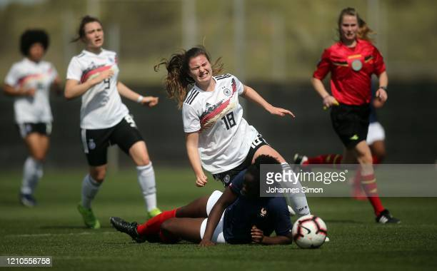 Chiara Marie Hahn of Germany and Kate Nado of France fight for the ball during the U19 Women's Tournament match between Germany and France at La...