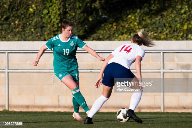 Chiara Marie Hahn of Germany plays the ball past Eleanor Hack of England during a friendly match between Germany U17 Girl's and England U17 Girl's on...