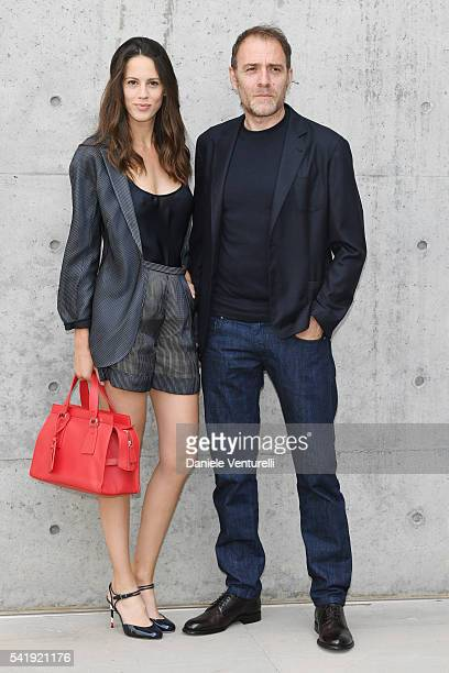 Chiara Martegiani and Valerio Mastandrea attend the Giorgio Armani show during Milan Men's Fashion Week SS17 on June 21 2016 in Milan Italy