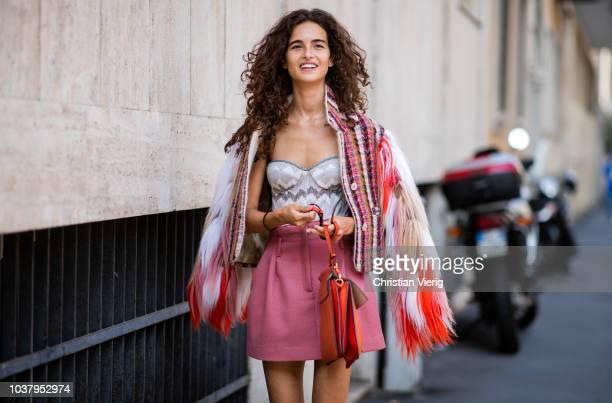 Chiara Scelsi wearing pink mini skirt sandals fake fur jacket during Milan Fashion Week Spring/Summer 2019 on September 21 2018 in Milan Italy