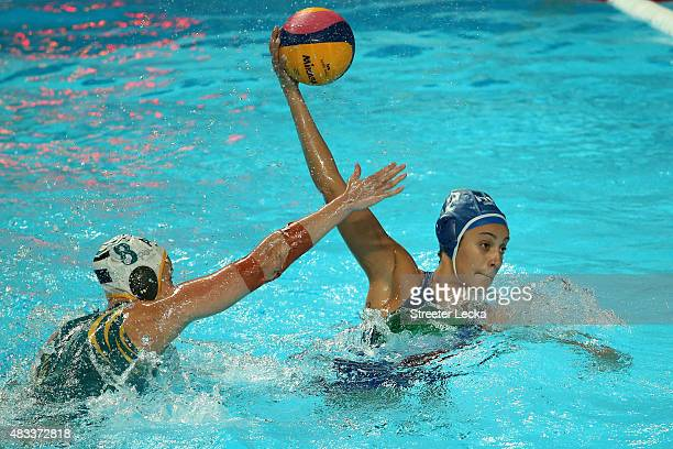 Chiara Tabani of Italy is challenged by Glennie Mcghie of Australia in the Women's bronze medal match between Australia and Italy on day fourteen of...