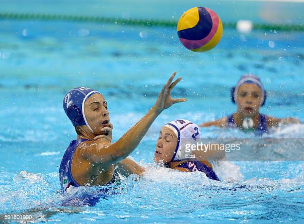 Chiara Tabani of Italy passes the ball as Ekaterina Lisunova of Russia defends during the Women's Water Polo at Olympic Aquatics Stadium on August 17...