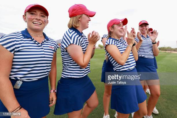 Chiara Tamburlini of the Ole Miss Rebels celebrates with her team after winning the Division I Womens Golf Championship held at the Grayhawk Golf...