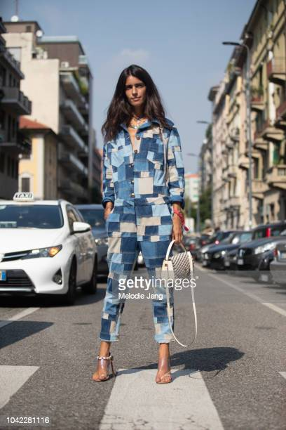 Chiara Totire at Etro in a blue denim patchwork jumpsuit white purse clear heels during Milan Fashion Week Spring/Summer 2019 on September 21 2018 in...