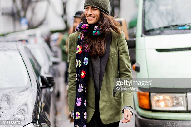 Chiara Totire is wearing a long green blazer jacket and a black scarf seen outside Giorgio Armani during Milan Fashion Week Fall/Winter 2016/17 on...